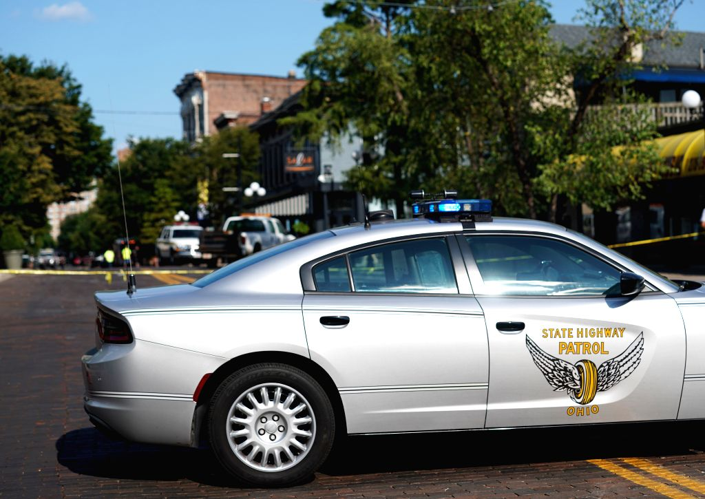 DAYTON (U.S.), Aug. 4, 2019 A police car is seen near the scene of mass shooting in Dayton of Ohio, the United States, on Aug. 4, 2019. Local police on Sunday identified the suspect of a ...
