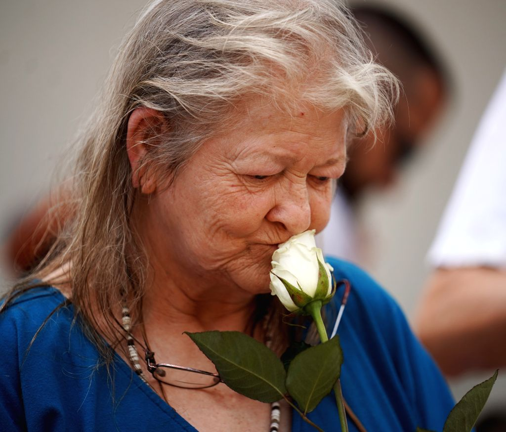 DAYTON (U.S.), Aug. 4, 2019 A woman attends a prayer vigil for the victims of the mass shooting in Dayton of Ohio, the United States, on Aug. 4, 2019. Nine people were killed with 26 ...
