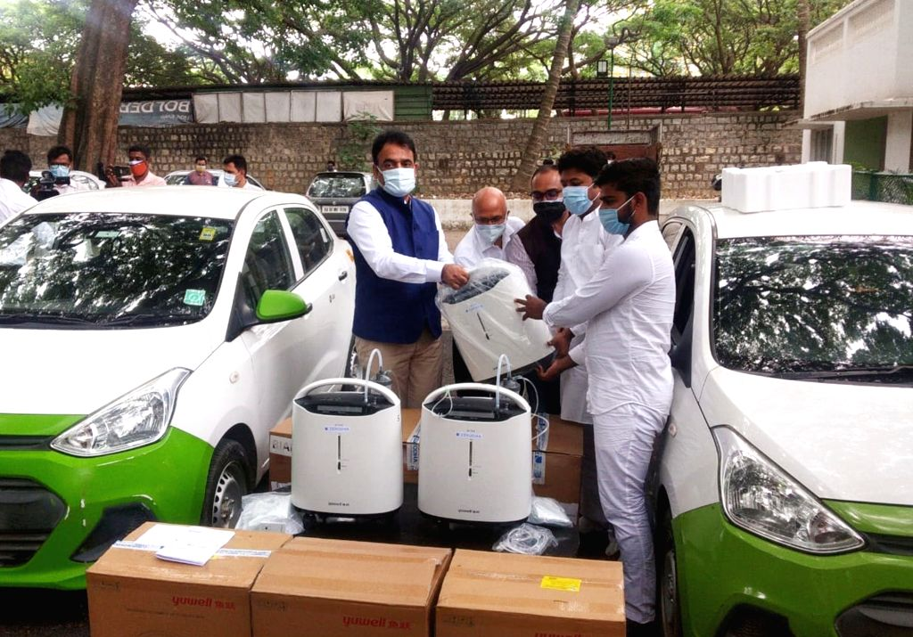 """DCM and State COVID Task Force Chairperson Dr C.N. Ashwatha Narayana launched an initiative of """"Delivery of Oxygen Concentrators to the Door Steps of the needy through Ola '' at ..."""