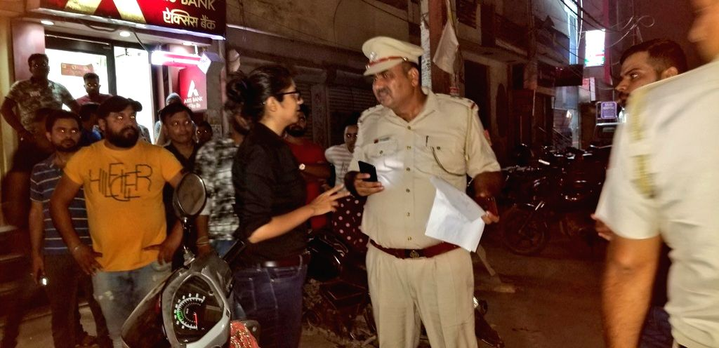 DCW chief Swati Maliwal along with police officials during a raid at a spa from where several girls were rescued in New Delhi on Sep 4, 2019.