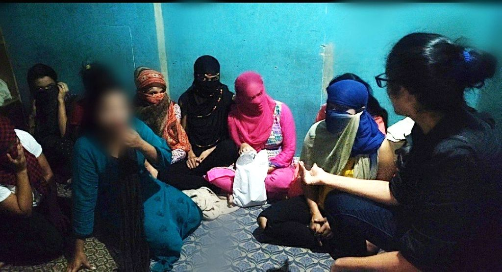 DCW chief Swati Maliwal with the girls who were rescued from a spa during a raid carried out by police in New Delhi on Sep 4, 2019.