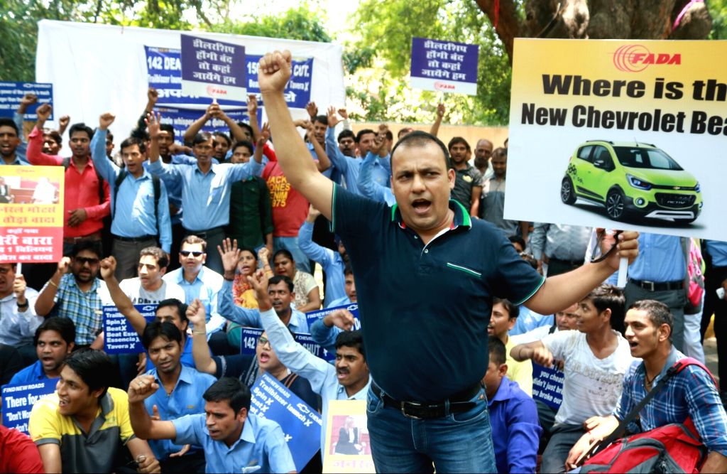 Dealers of General Motors stage a demonstration to press for their demands at Jantar Mantar in New Delhi, on June 27, 2017.