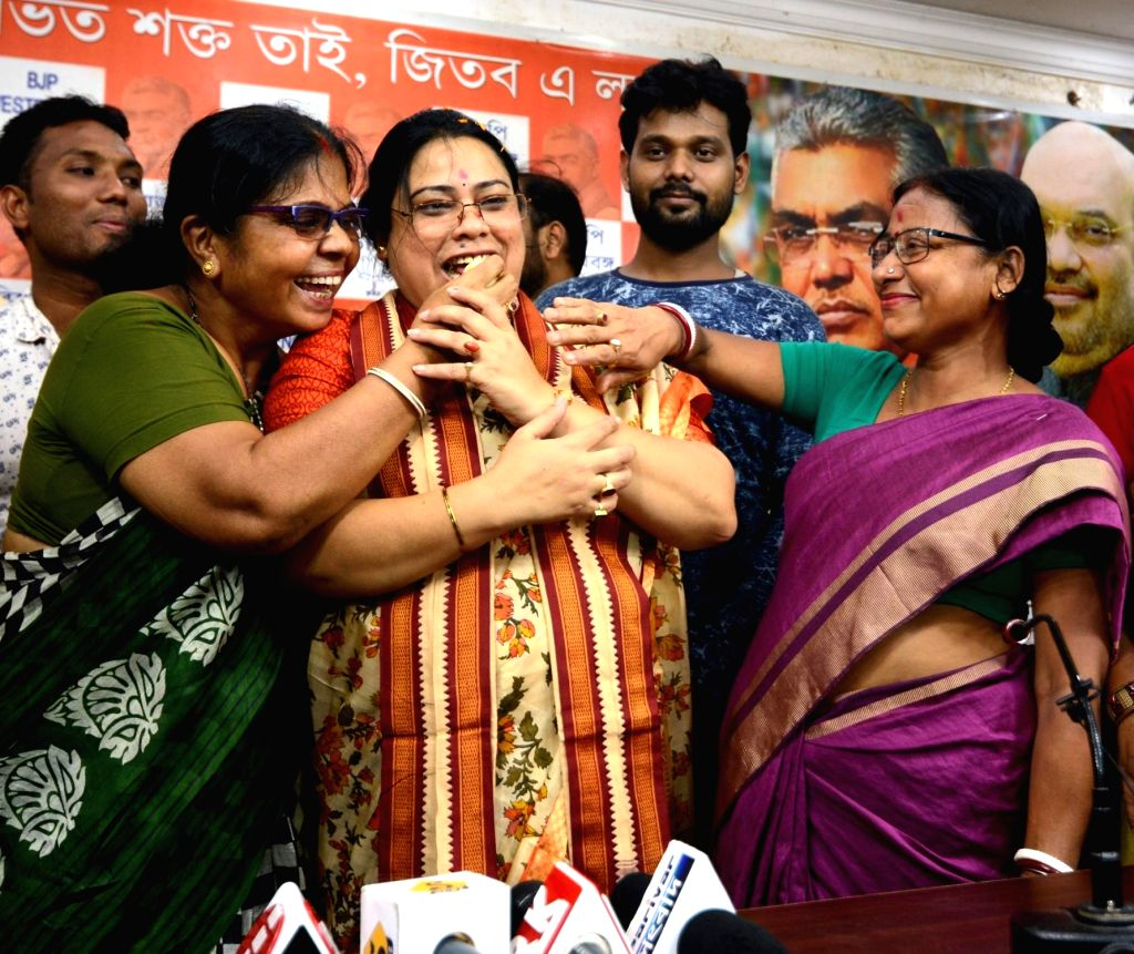 Debasree Chaudhuri being greeted by party workers after taking charge as Minister of State for Women and Child Development, at a press conference at the West Bengal BJP headquarter in ...