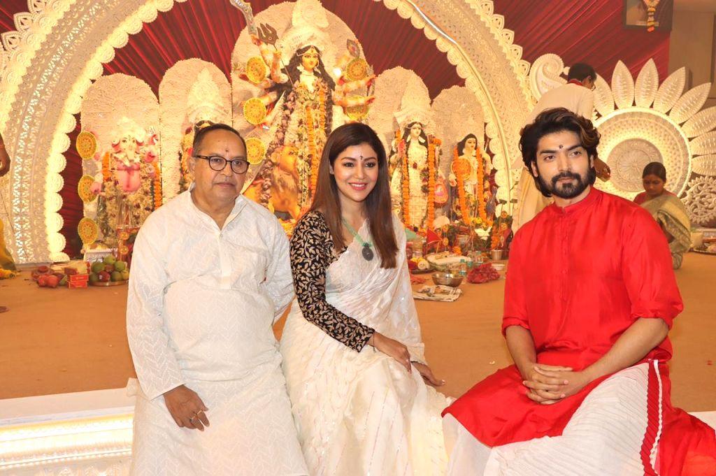 Debina Bonnerjee and Gurmeet Choudhary attend At North Bombay Durga Puja Samiti on the occasion of Maha Navami in Mumbai on Thursday October 14, 2021. - Debina Bonnerjee and Gurmeet Choudhary