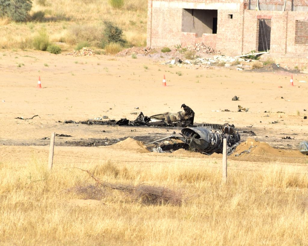 Debris of a MiG-21 fighter aircraft of the Indian Air Force (IAF) that crashed near Bikaner in Rajasthan on March 8, 2019. The pilot ejected safely.