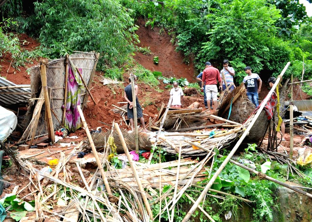 Debris of the houses destroyed in a landslide in Panikhaiti of Assam's Kamrup district on July 3, 2017.