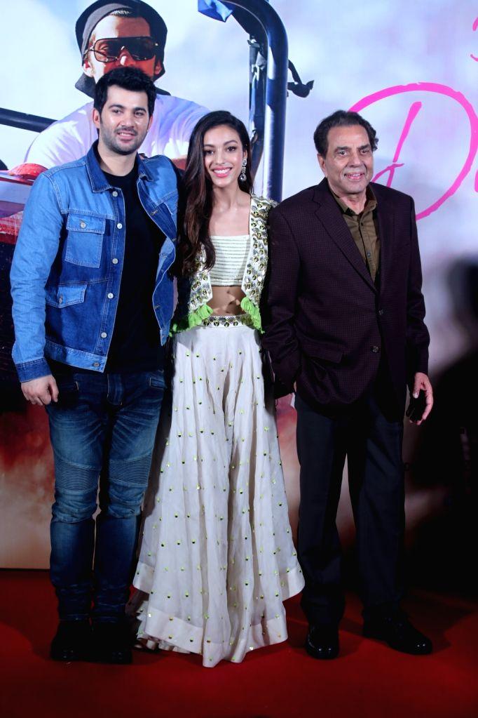 "Debutants Karan Deol, Sahher Bambba with actor Dharmendra at the trailer launch of their upcoming film ""Pal Pal Dil Ke Paas"" in Mumbai, on Sep 5, 2019. - Dharmendra"
