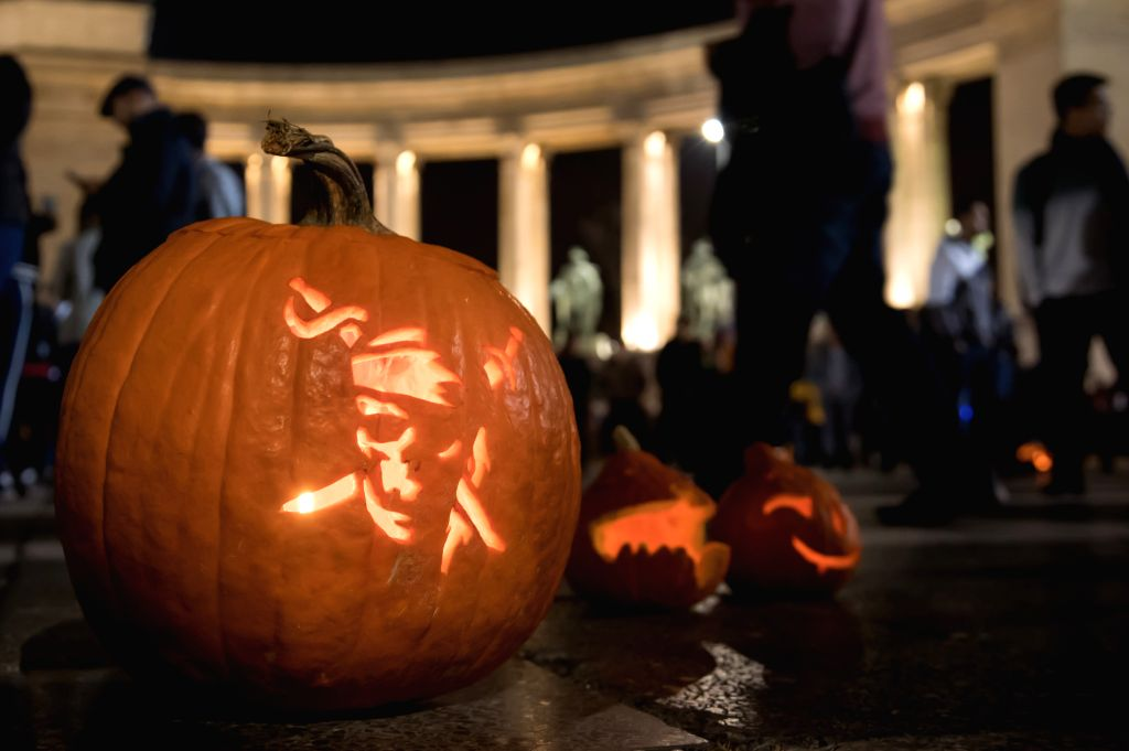 : Decorated pumpkins are seen on display at the Halloween Pumpkin Festival held on Heroes' Square in downtown Budapest, Hungary on Oct. 27, 2018. Halloween ...