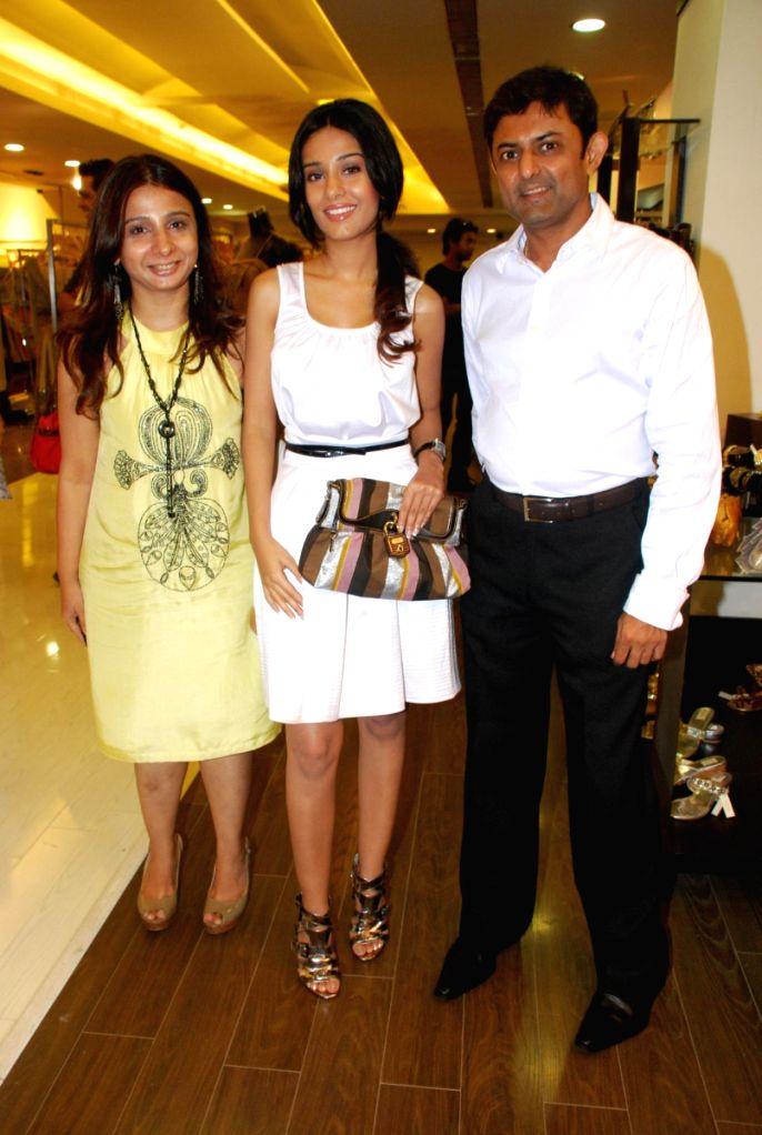 Deepa and Amith Dholakia with Amrita Rao at Amara Store.