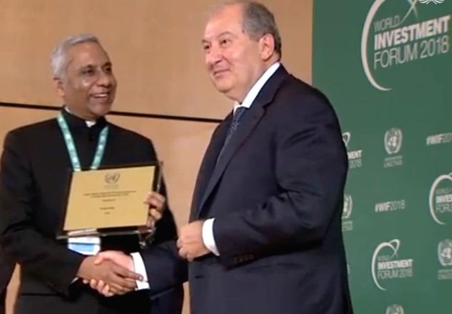 : Deepak Bagla, the CEO of Invest India, receives the top United Nations Investment Promotion Award from Armenian President Armen Sarkissian at the World Investment Forum in Geneva on Monday, Oct. ...