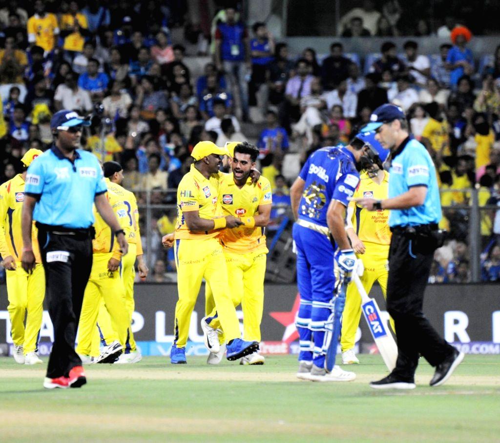 Deepak Chahar of Chennai Super Kings celebrates fall of Evin Lewis' wicket during an IPL 2018 match between Mumbai Indians and Chennai Super Kings at Wankhede Stadium in Mumbai on April 7, ...
