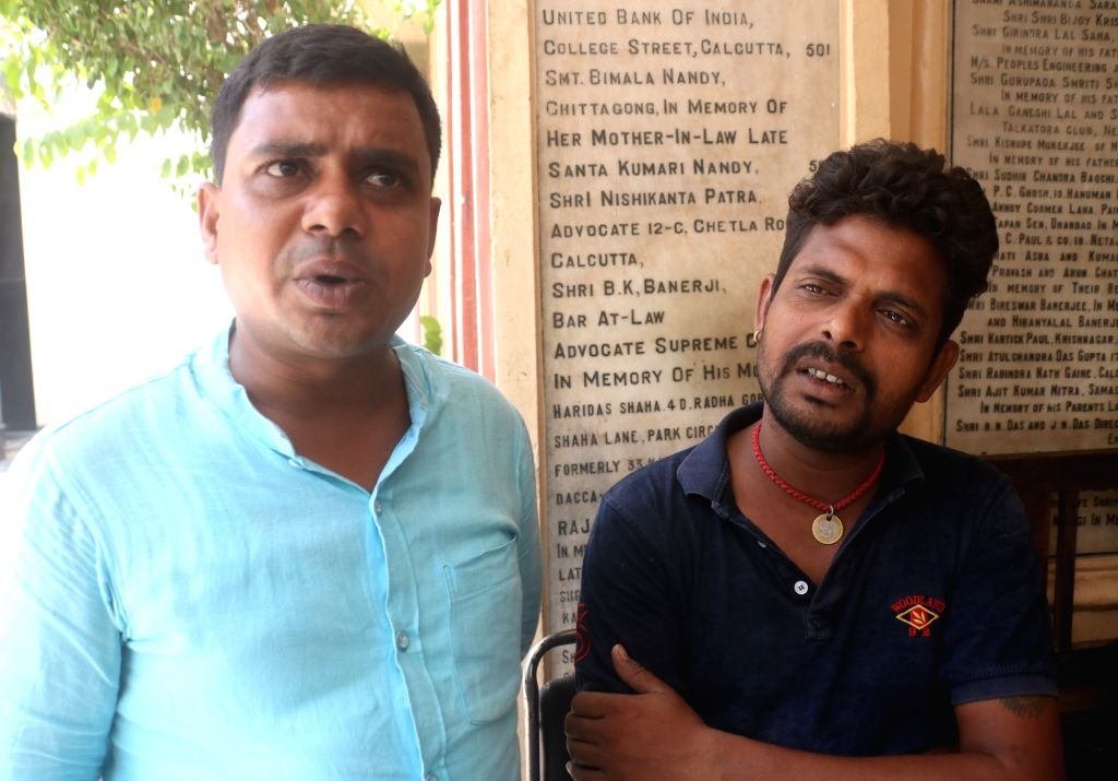 Deepak Kumar Shaw and Rajesh Kumar Shaw, brothers of BJP worker Chandan Kumar Shaw who was shot dead in an incident of political violence during the 2019 Lok Sabha elections in West ... - Narendra Modi, Deepak Kumar Shaw, Rajesh Kumar Shaw and Chandan Kumar Shaw
