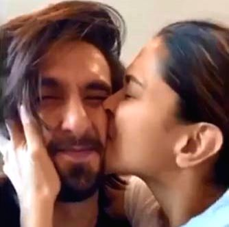 Deepika kisses 'cutie' Ranveer's 'squishable face'.