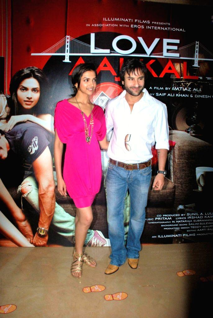 "Deepika Padukone and Saif Ali Khan at a press meet of movie ""Love Aaj Kal"" at PVR, in Mumbai. - Deepika Padukone"