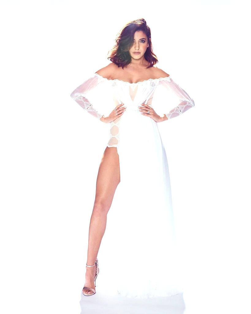 Deepika Padukone cannot stop gushing over photographs that Anushka Sharma has shared on social media. In the snapshots that Anushka shared on Instagram, she is seen wearing a pristine-white thigh-high slit dress. - Deepika Padukone and Anushka Sharma