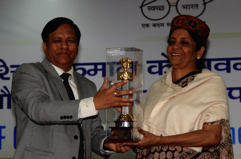 Defence Estates DG Jojneswar Sharma felicitates Union Defence Minister Nirmala Sitharaman during a felicitation ceremony at St. Marry's convent school in Kasauli, Himachal Pradesh on Sept ... - Nirmala Sitharaman and Jojneswar Sharma