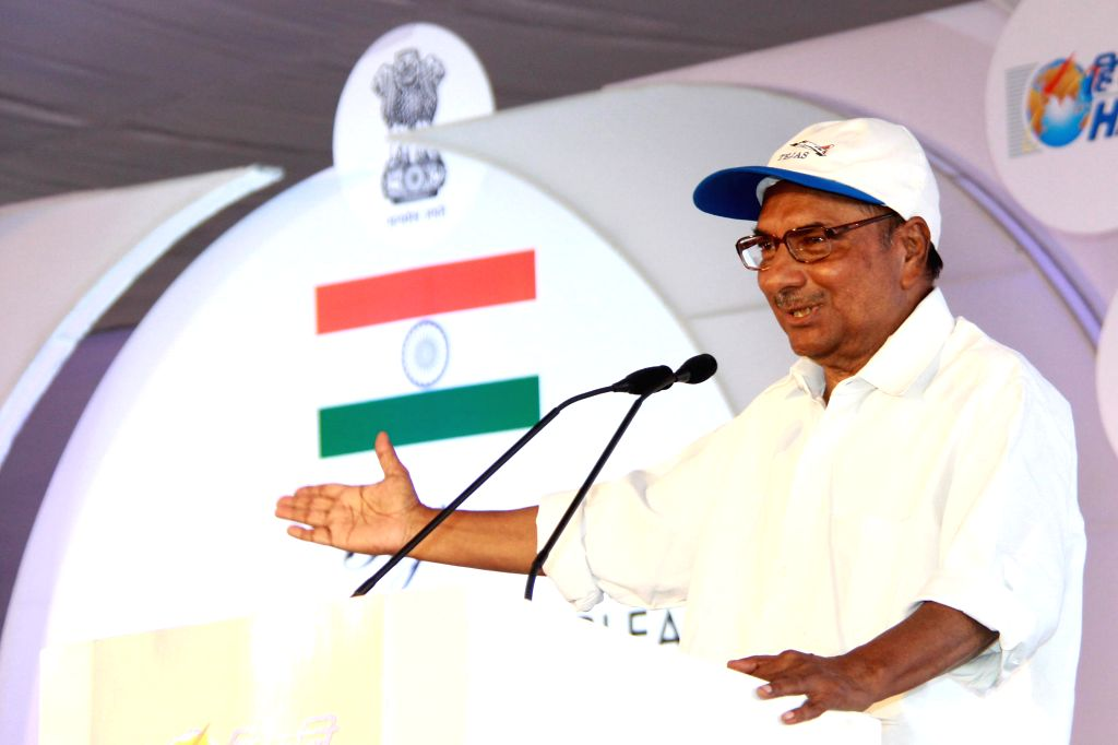 :Defence Minister A.K. Antony addresses during a programme where indigenously-designed `Tejas`, regarded as the smallest and the lightest combat jet in the world was inducted into Air Force after ...