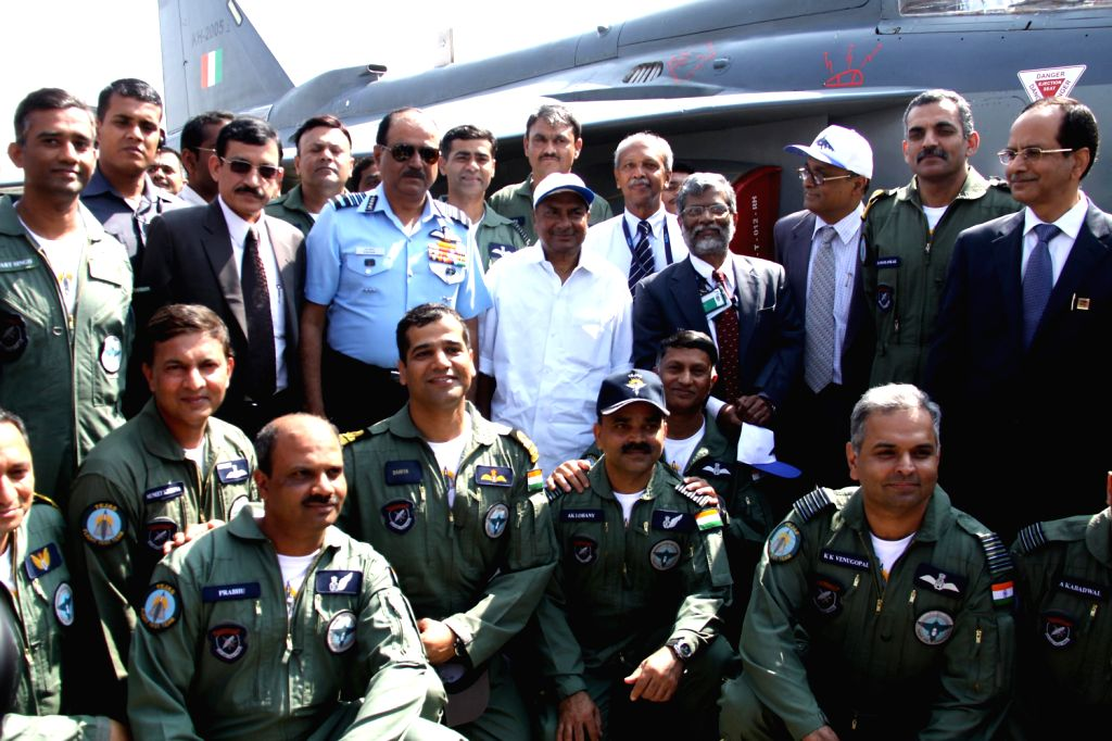 Defence Minister A.K. Antony and Air Chief Marshal NAK Browne with team `Tejas` during a programme where indigenously-designed `Tejas`, regarded as the smallest and the lightest combat jet in the ...