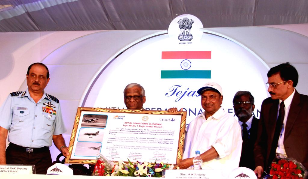 Defence Minister A.K. Antony and Air Chief Marshal NAK Browne during a programme where indigenously-designed `Tejas`, regarded as the smallest and the lightest combat jet in the world was inducted ...