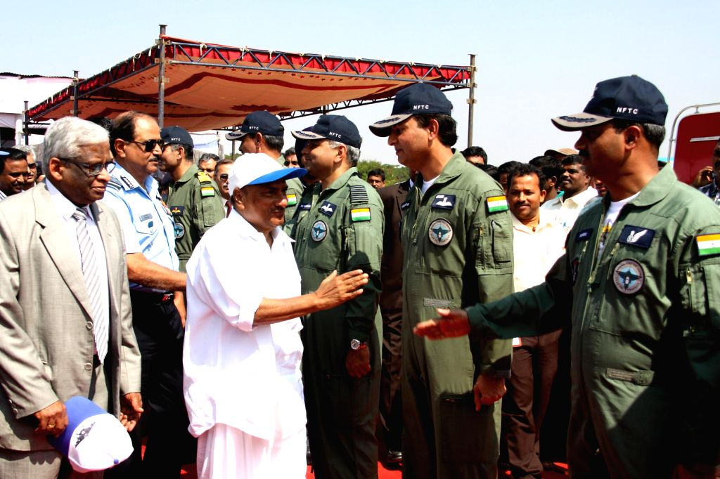 Defence Minister A.K. Antony interacts with pilots during a programme where indigenously-designed `Tejas`, regarded as the smallest and the lightest combat jet in the world was inducted into Air ...