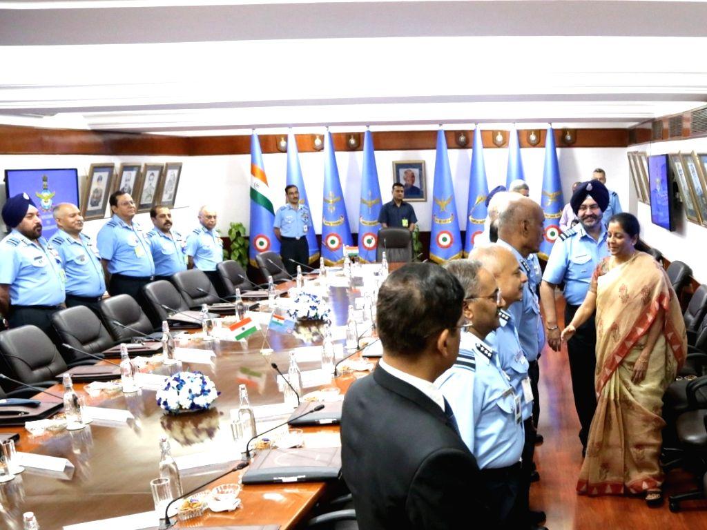 Defence Minister Nirmala Sitaraman accompanied by Air Chief Marshal B.S. Dhanoa during the  IAF Commanders??? Conference at Air Headquarters (Vayu Bhavan), in New Delhi, on April 11, 2019. - Nirmala Sitaraman