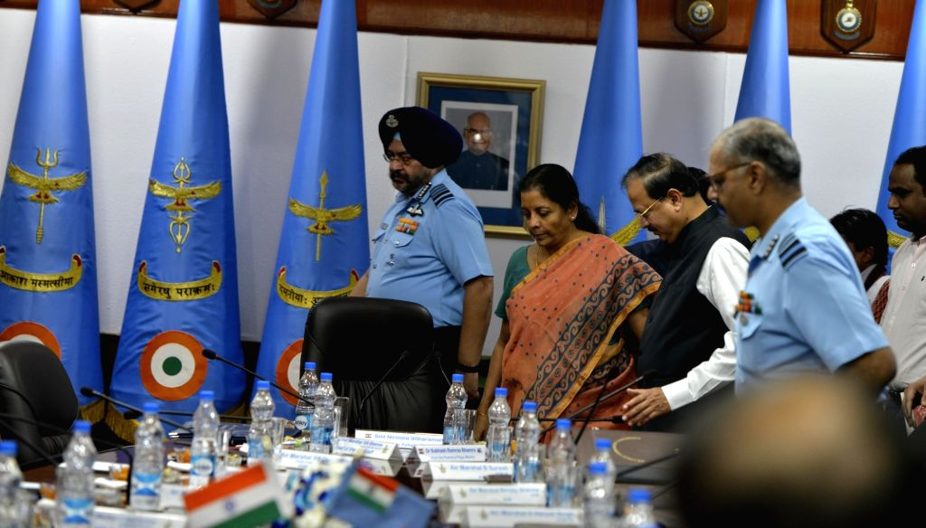 Defence Minister Nirmala Sitaraman with Air Chief Marshal BS Dhanoa during the inaugural session of IAF Commanders Conference at Air Headquarters(Vayu Bhavan) in New Delhi on Oct. 10, 2017. - Nirmala Sitaraman