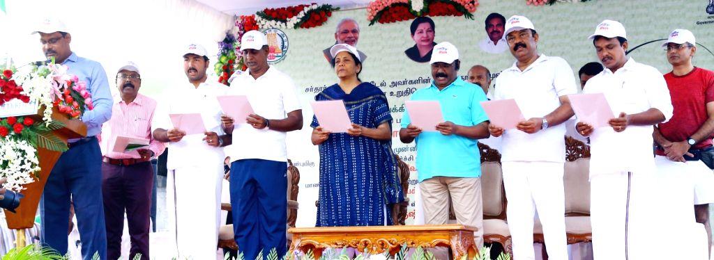 Defence Minister Nirmala Sitharaman administers 'Rashtriya Ekta Diwas' pledge on the birth anniversary of the country's first Home Minister Sardar Vallabhbhai Patel in Chennai on Oct 31, ... - Nirmala Sitharaman and Sardar Vallabhbhai Patel