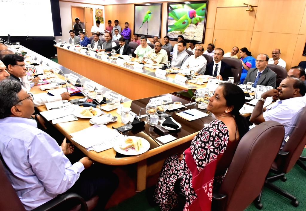 Defence Minister Nirmala Sitharaman and Karnataka Chief Minister HD Kumaraswamy during a programme to discuss transfer of defence land for infrastructure developments projects, in ... - Nirmala Sitharaman