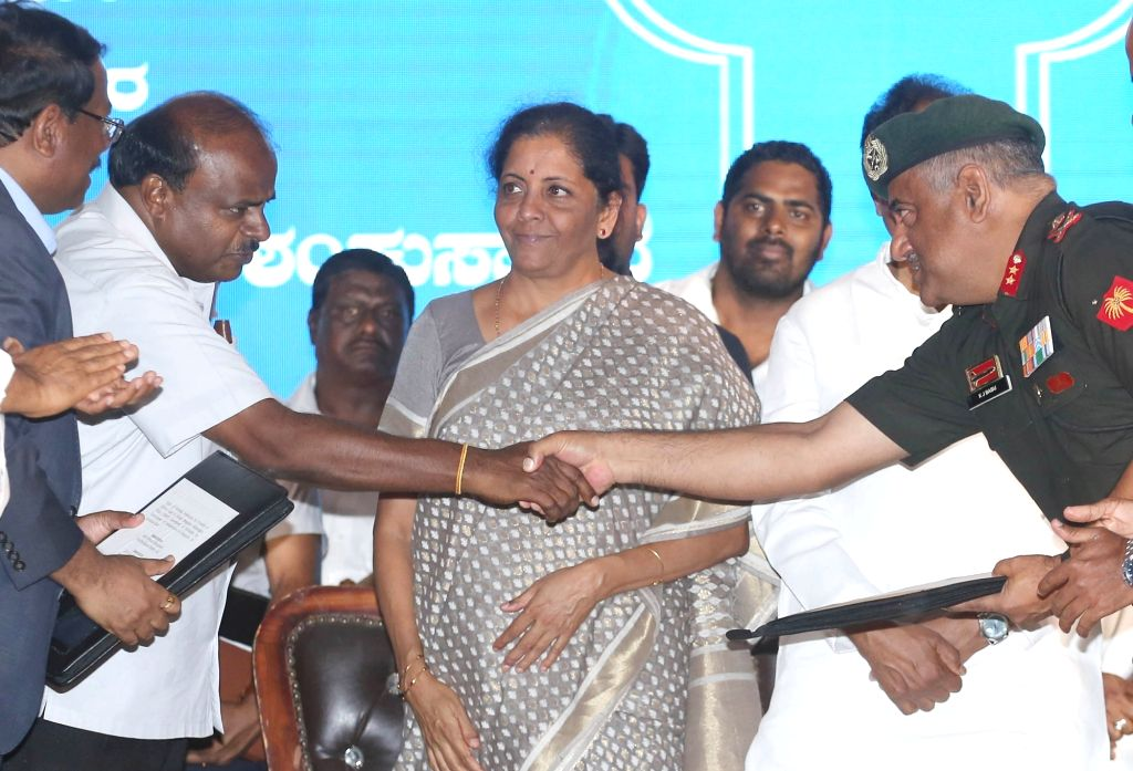 Defence Minister Nirmala Sitharaman and Karnataka Chief Minister HD Kumaraswamy at the inauguration of various projects funded by Karnataka government and handing over the properties from ... - Nirmala Sitharaman