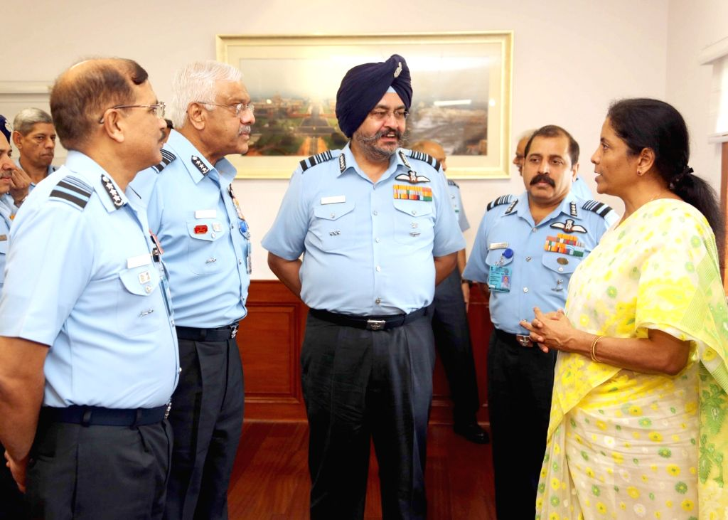 Defence Minister Nirmala Sitharaman interacts with Chief of the Air Staff, Air Chief Marshal B.S. Dhanoa during the Air Force Commanders' Conference, in New Delhi on May 31, 2018. - Nirmala Sitharaman