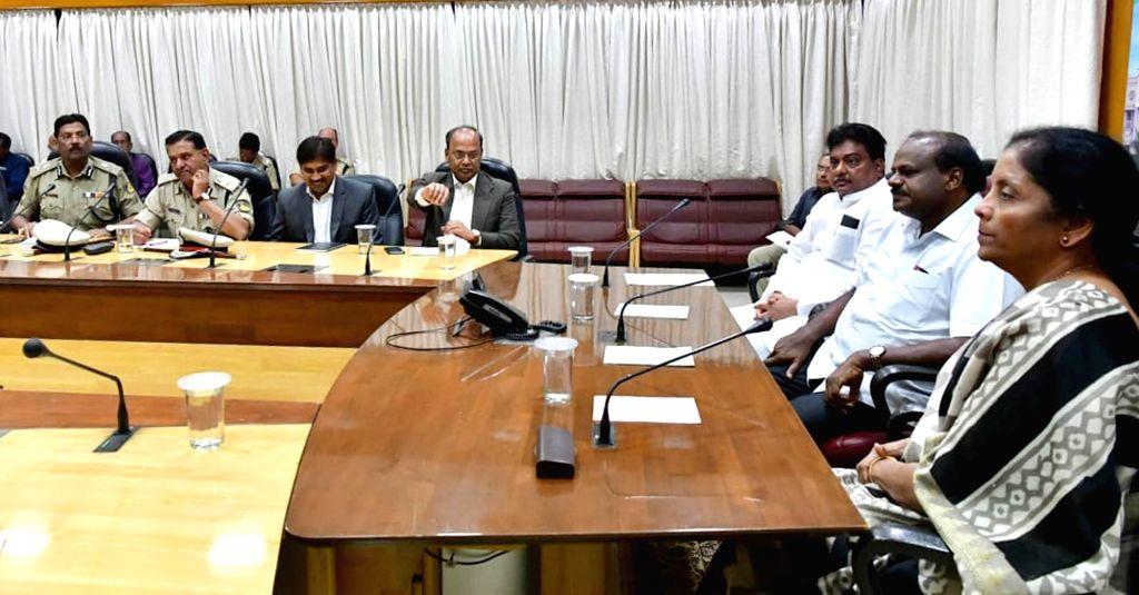 Defence Minister Nirmala Sitharaman, Karnataka Chief Minister HD Kumaraswamy and Home Minister MB Patil and others during a high level meeting regarding Aero India Show, in Bengaluru on ... - Nirmala Sitharaman