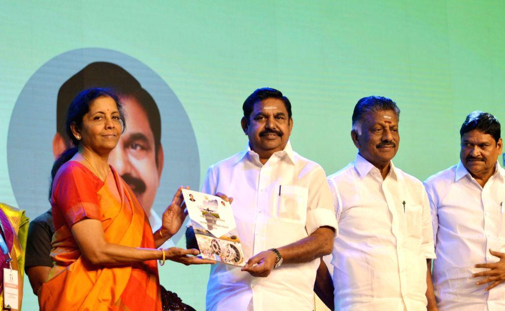 Defence Minister Nirmala Sitharaman presents the first copy of 'TN Aerospace and Defence Policy' to Tamil Naidu Chief Minister Edappadi K. Palanisamy at the Tamil Nadu Global Investors ... - Nirmala Sitharaman and Edappadi K. Palanisamy