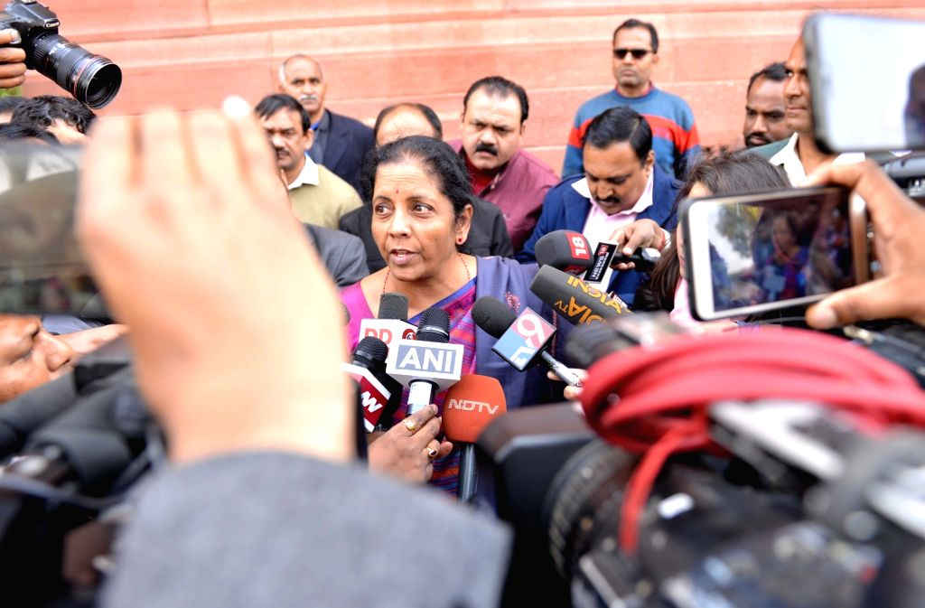 Defence Minister Nirmala Sitharaman talks to media persons at Parliament in New Delhi, on Feb 8, 2019. - Nirmala Sitharaman