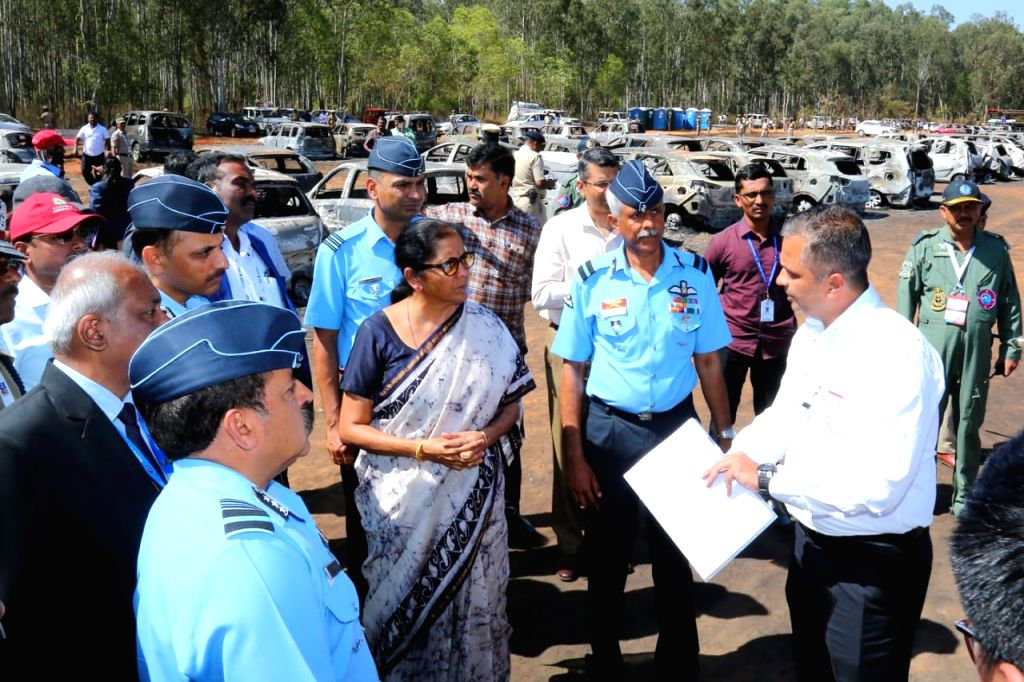 Defence Minister Nirmala Sitharaman visits the site, where a fire broke out at the parking lot in front of Yelahanka Air Force Station gutting 300 cars, in Bengaluru, on Feb 24, 2019. - Nirmala Sitharaman
