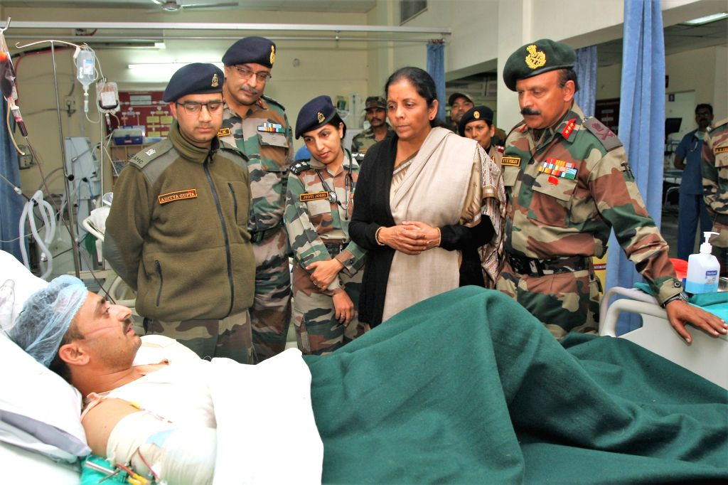 Defence Minister Nirmala Sitharaman with GOC Rising Star Corps, Lt. Gen. Y.V.K. Mohan during her visit to the 166 Military Hospital to meet the injured soldiers and family members of Sunjuwan ... - Nirmala Sitharaman