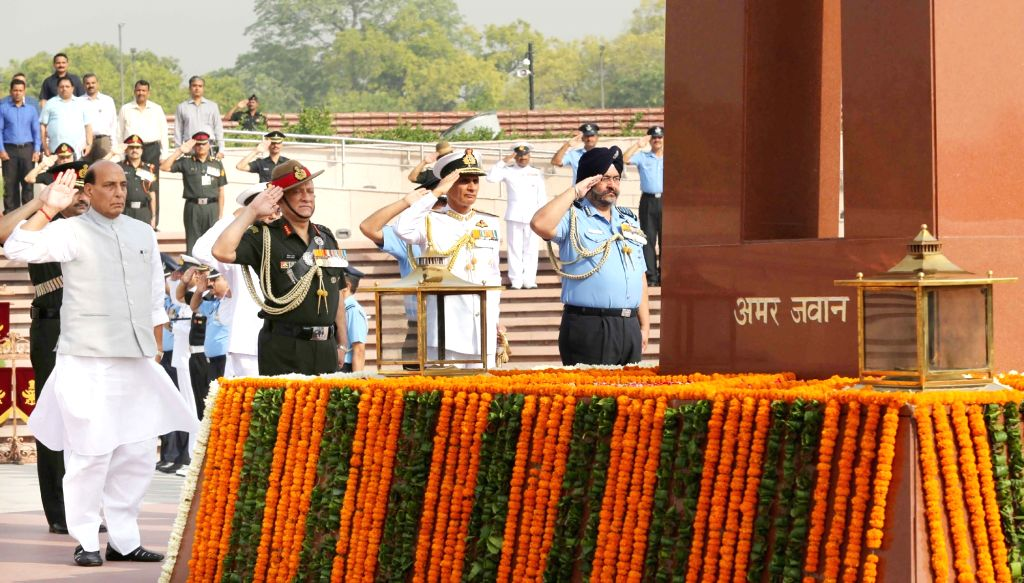 Defence Minister Rajnath Singh along with three Services??? Chiefs - Army Chief General Bipin Rawat, Navy Chief Admiral Karambir Singh and Air Chief Marshal B.S. Dhanoa, pay homage to the ... - Rajnath Singh