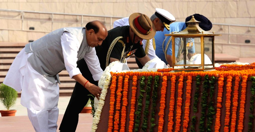 Defence Minister Rajnath Singh along with three Services??? Chiefs - Army Chief General Bipin Rawat, Navy Chief Admiral Karambir Singh and Air Chief Marshal B.S. Dhanoa, lays wreath on the ... - Rajnath Singh