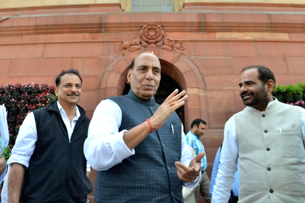 Defence Minister Rajnath Singh and BJP MPs Rajiv Pratap Rudy and Ramesh Bhiduri at Parliament in New Delhi on March 18, 2020. - Rajnath Singh