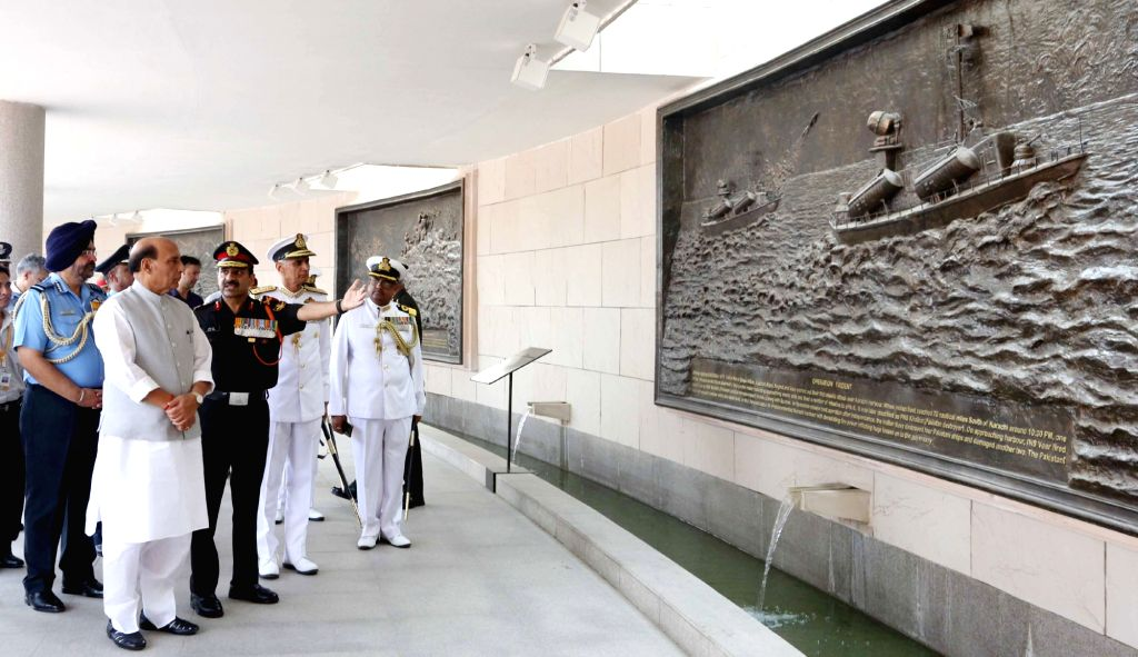 Defence Minister Rajnath Singh catches the glimpse of the murals depicting famous battles at the National War Memorial in New Delhi on June 1, 2019. Also seen Chief of the Air Staff ... - Rajnath Singh