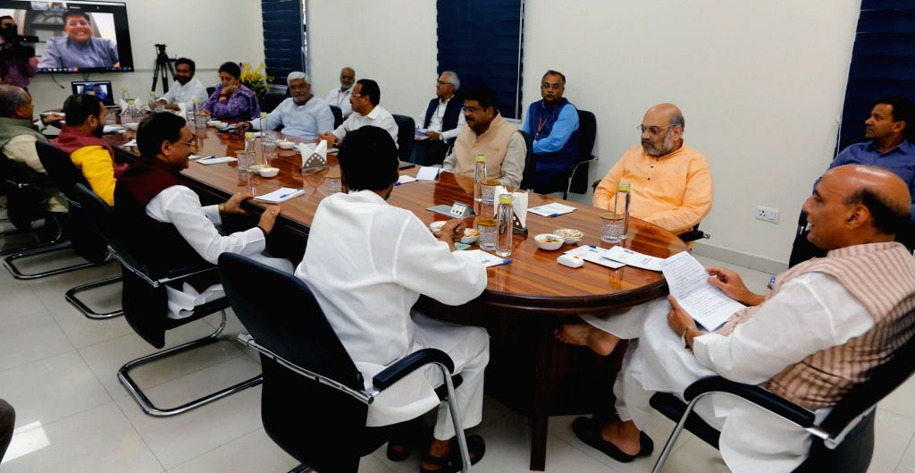 Defence Minister Rajnath Singh chairs the meeting of Group of Ministers to review measures undertaken to fight COVID-19 through video conferencing, in New Delhi on March 29, 2020. Also ... - Rajnath Singh, Ministers Amit Shah, Ram Vilas Paswan, Ramesh Pokhriyal, Narendra Singh Tomar, Gajendra Singh Shekhawat, Smriti Irani and G. Kishan Reddy