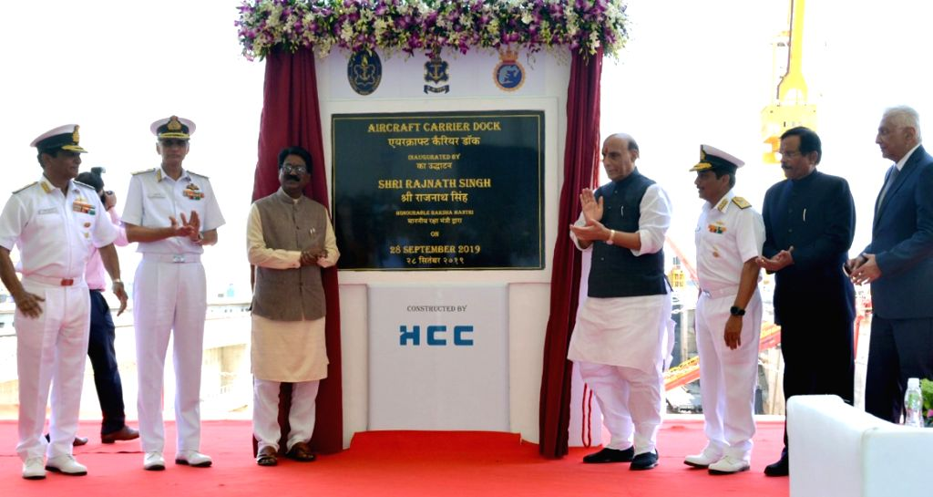 Defence Minister Rajnath Singh inaugurates the Aircraft Carrier Dry Dock, at Naval Dockyard, in Mumbai on Sep 28, 2019. Also seen Union MoS AYUSH (Independent Charge) and Defence Shripad ... - Rajnath Singh