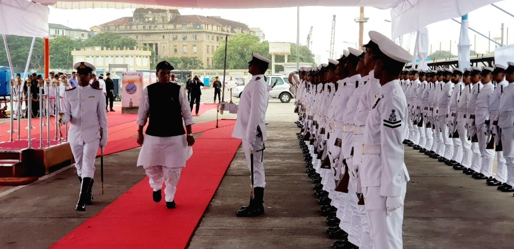 Defence Minister Rajnath Singh inspects the Guard of Honour on his arrival at the commissioning ceremony of India's second Scorpene-class attack submarine INS Khanderi into the Indian Navy, ... - Rajnath Singh
