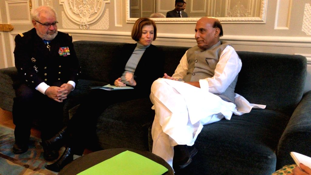 Defence Minister Rajnath Singh meets French Armed Forces Minister Florence Parly and the Defence Advisor to the French President, Admiral Bernard Rogel at Elys??e Palace in Paris on Oct 8, ... - Rajnath Singh