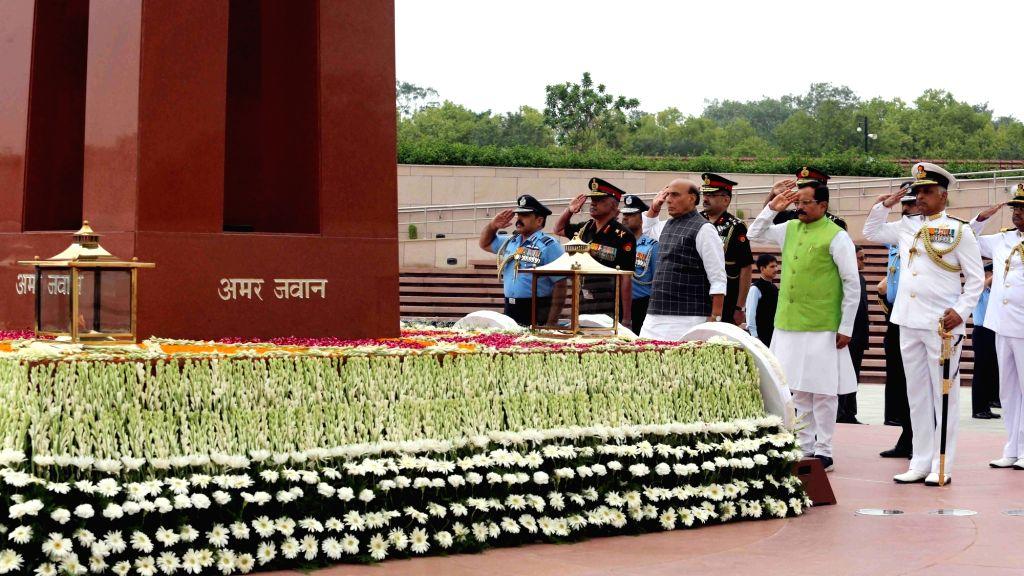 Defence Minister Rajnath Singh, MoS Defence Shripad Yesso Naik, Vice Chief of the Army Staff Lieutenant General Devraj Anbu, Vice Chief of the Naval Staff Vice Admiral G. Ashok Kumar and ... - Rajnath Singh
