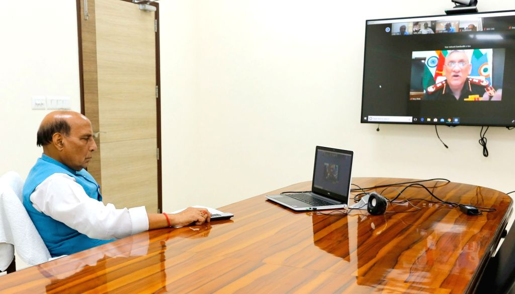Defence Minister Rajnath Singh reviews efforts being undertaken to contain Coronavirus (COVID-19) with Chief of Defence Staff (CDS), General Bipin Rawat through video conferencing, in New ... - Rajnath Singh