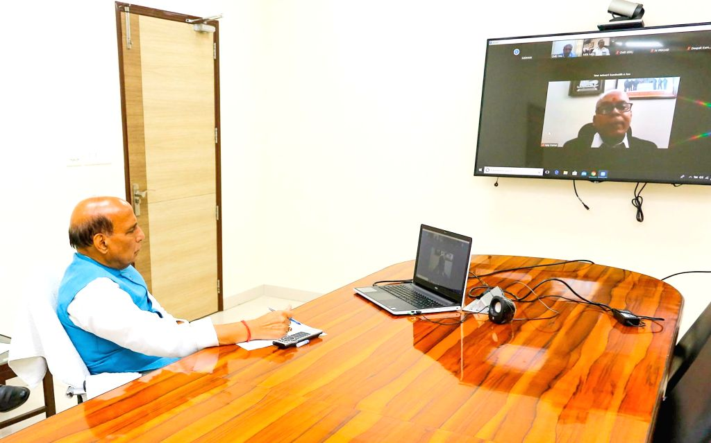 Defence Minister Rajnath Singh reviews efforts being undertaken to contain Coronavirus (COVID-19) with Defence Secretary Ajay Kumar through video conferencing, in New Delhi on Apr 1, 2020. - Rajnath Singh and Secretary Ajay Kumar