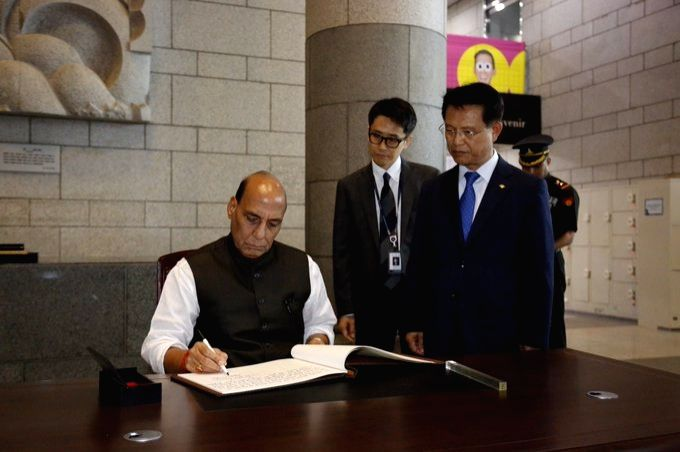 Defence Minister Rajnath Singh signs the Visitors' Book at the War Memorial in Seoul, Republic of Korea on Sep 5, 2019. - Rajnath Singh