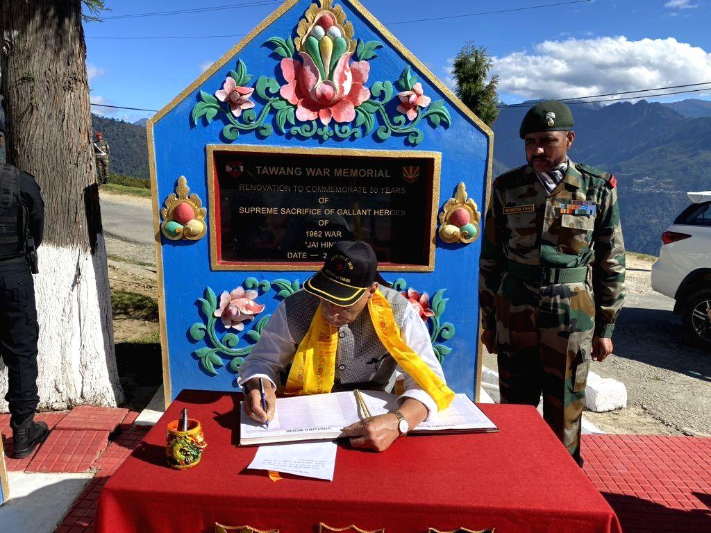 Defence Minister Rajnath Singh signs the Visitors' Book of Tawang War Memorial in Arunachal Pradesh's Tawang on Nov 14, 2019. - Rajnath Singh