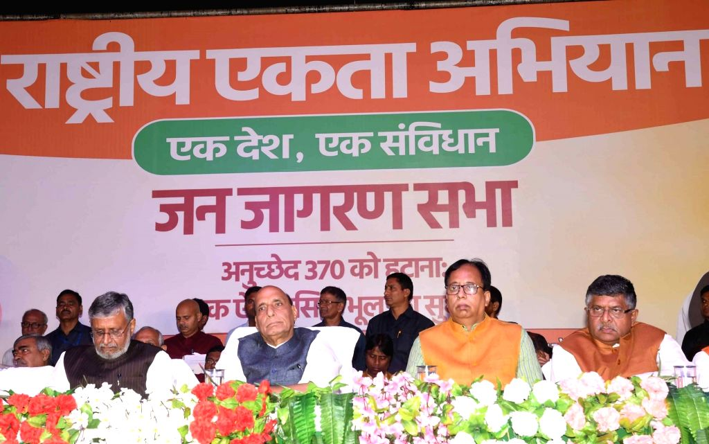 Defence Minister Rajnath Singh, Union Law and Justice, Communications and Electronics and Information Technology Minister Ravi Shankar Prasad and Bihar Deputy Chief Minister Sushil Kumar Modi ... - Rajnath Singh and Sushil Kumar Modi