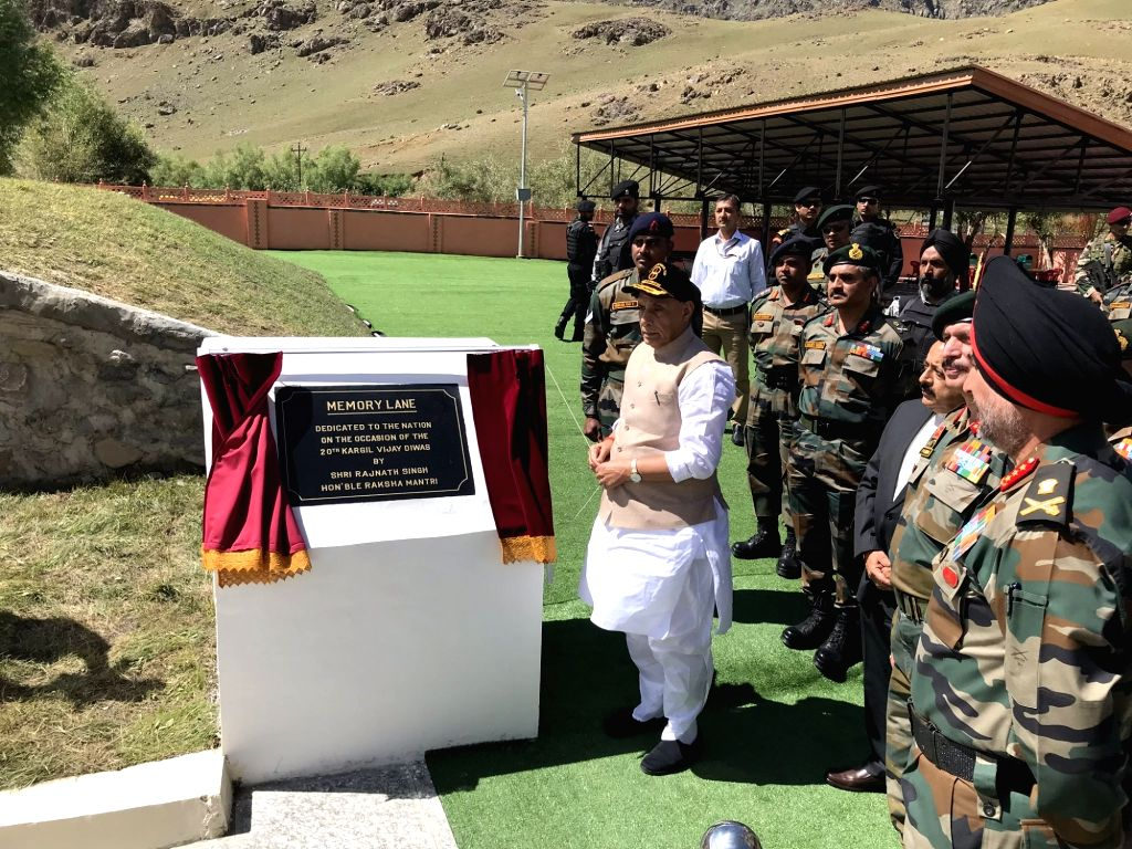 Defence Minister Rajnath Singh unveils the plaque to inaugurate 'Memory Lane' at Kargil War Memorial in Dras of Jammu and Kashmir's Kargil district, on July 20, 2019. - Rajnath Singh